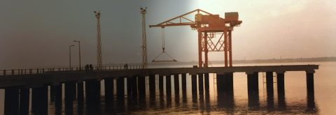 Berthing Jetty With Container Handling Crane on River Ganges